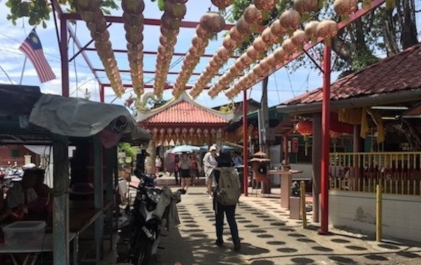 Clan Jetties: A photo of Chew Jetty's entrance with hanging Chinese lanterns.