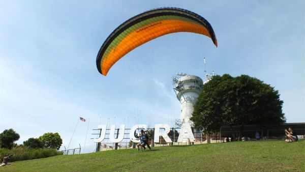 The cliff of Bukit Jugra where paragliders take off and fly