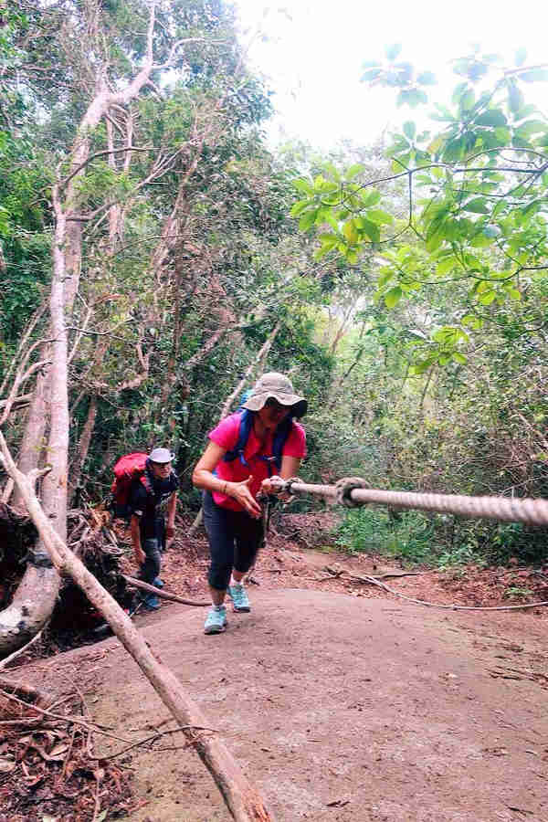 Negotiating the rope at Batu Hampar on our hike up Gunung Ledang
