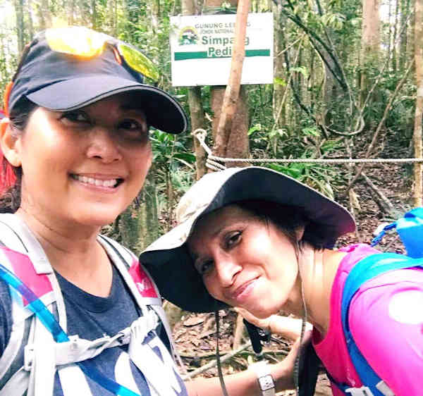 Two friends on their hike up Gunung Ledang