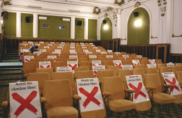 An empty cinema hall, showing alternative seats being blocked off to enforce social distancing in 2020.