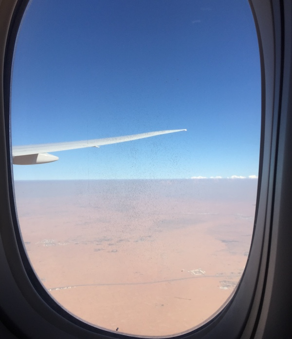 A photo of the desert in Saudi Arabia from the view of a window plane.