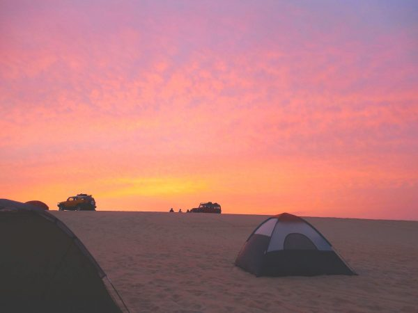 A photo of a camping site in Saudi Arabia with tents all around.