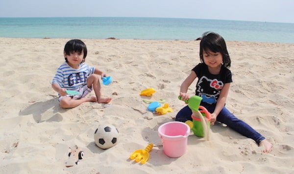 A photo of Atiqah's baby sibblings at the beach.
