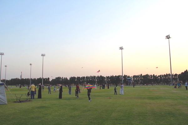 A photo of kite flying in a community gathering in Saudi.