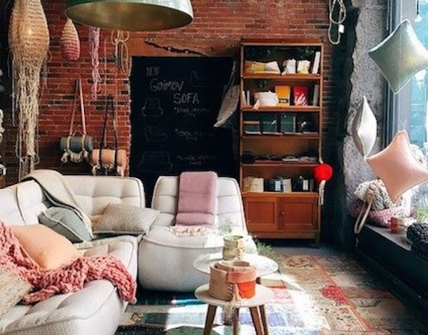 A living room with cozy pillows and cushions. The destination I hope for my heritage road trip.
