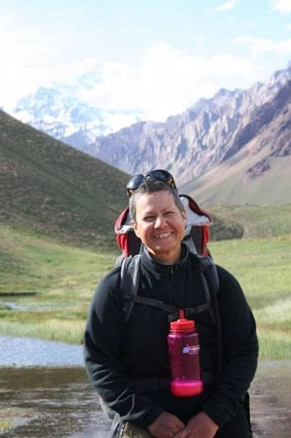 Renée stands proud with Mount Aconcagua at the background, her team may not have reached the summit but the they succeeded in raising cancer awareness with a documentary and media coverage.
