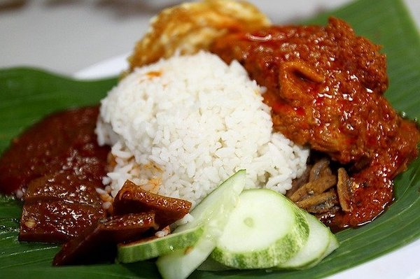 Rice cooked with coconut milk with sides of slice cucumber, fried egg, and squid sambal, a mum's must menu.