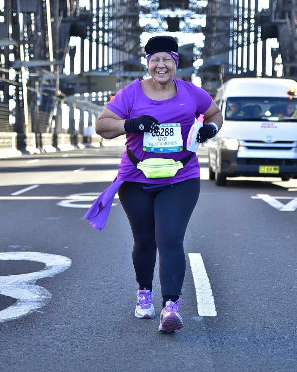 Running on the Sydney Harbour Bridge at the Sydney Marathon. Renée raised awareness and some funds for Breast Cancer Network Australia.