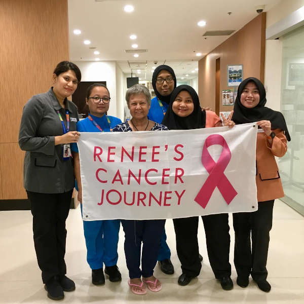 Renée's cancer journey is a banner that tells her story. A photo opportunity with some of the medical staff at the hospital where Renée receives medical treatment.