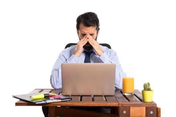 Brutal workplace: Man feeling frustrated at work