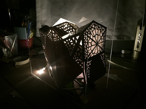 A picture of my final studio design model with lights penetrating.