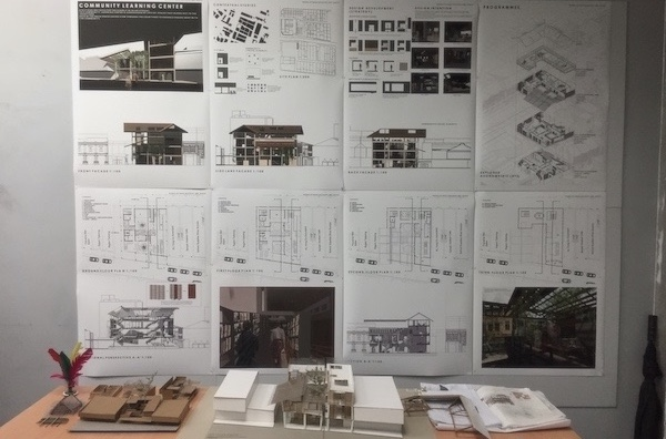 Architecture: A picture of Atiqah's final presentation in Semester 5 with her A1 boards pinned up.