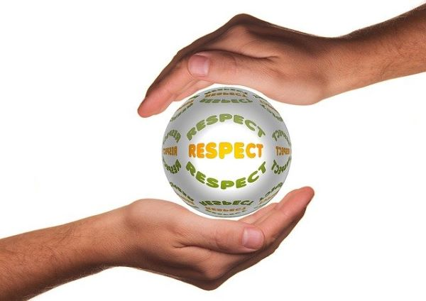"""A pair of hands holding a ball called """"Respect"""""""