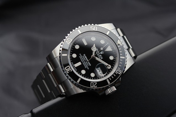 Rolex Submariner with black dial, black rotating bezel and Oyster bracelet, representing a dive watch. A sport watch is one of the three watches everyone should have.
