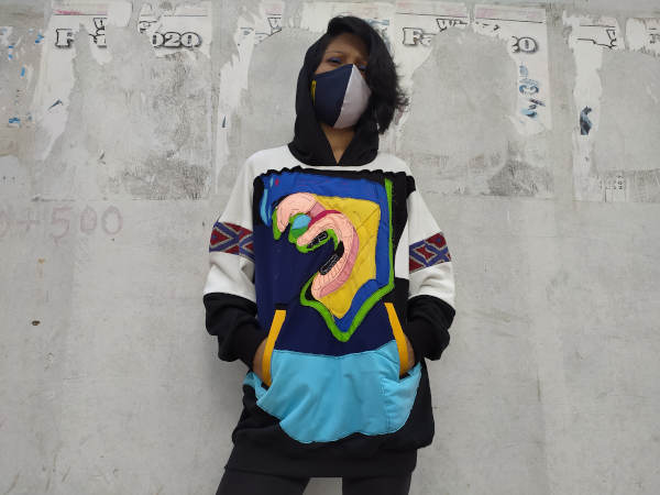 Mahenez wearing one of the high fashion streetwear designs in the Broqué clothing line. She often incorporates brightly coloured fabric into her apparels.