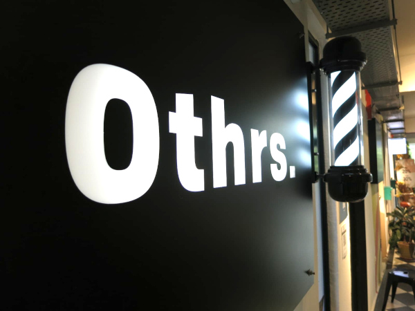 Signage of Othrs Barbers