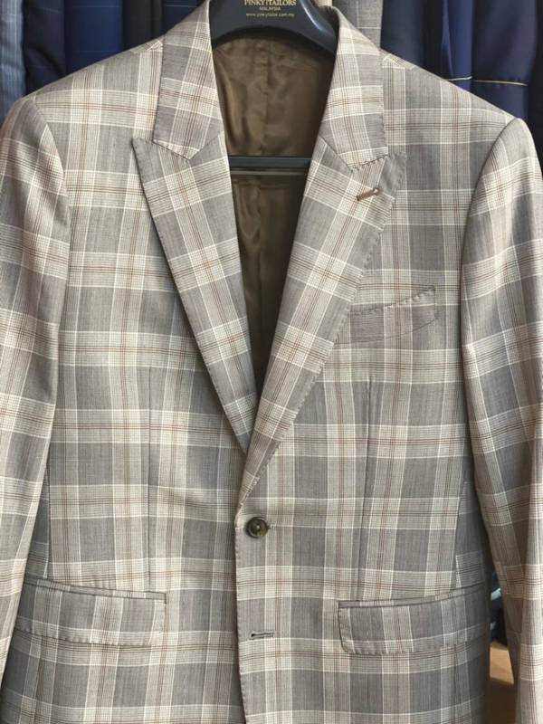 A checkered pattern jacket made from linen and lighter tone.