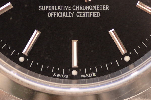 """Macro view of the lower quarter of a Rolex dial, emphasising on the words """"Swiss Made"""". This is the typical indication of a Swiss watch."""