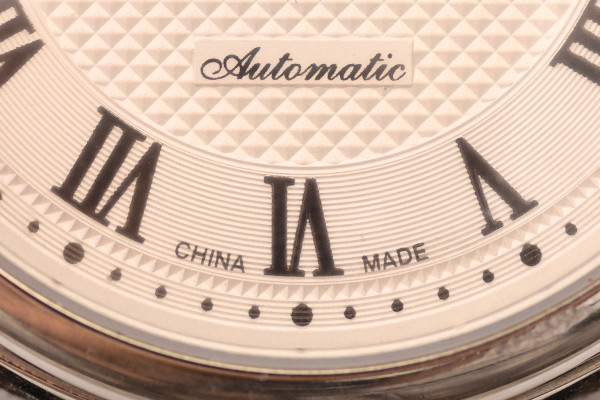 """Macro view of the lower quarter of a Sea-Gull dial, emphasising on the words """"China Made"""". This is the atypical indication that the watch is NOT a Swiss watch."""