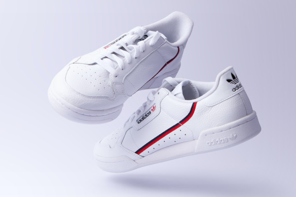 A pair of white trainers. This is the antithesis of the dress shoes.