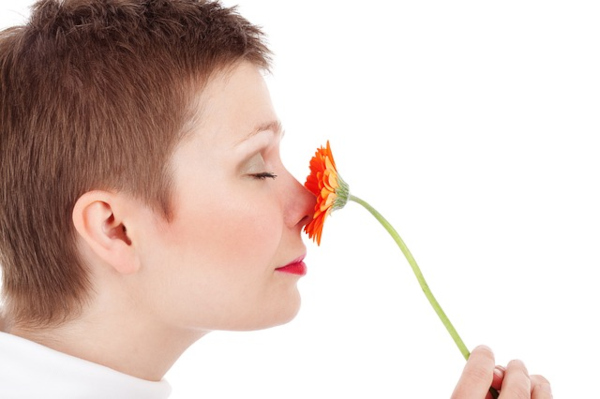 Lady smelling flower