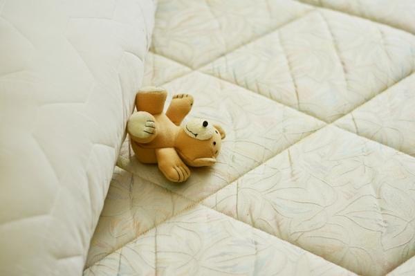 Sleep problem: Teddy bear sleeping on mattress