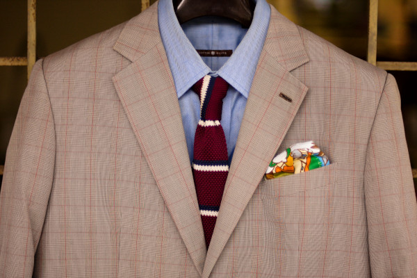 Close-up of a playful business casual attire as described in the caption.