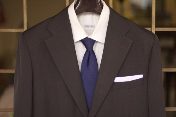 Close up of a conservative business formal attire as described in the caption.