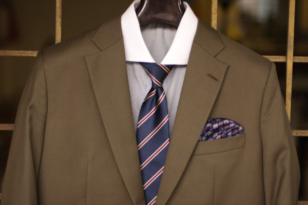 Close up of a semi-formal business formal attire as described in the caption.