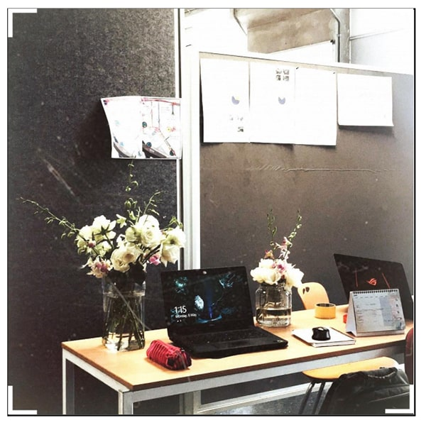 A photo of Natasya's studio space, surrounded by flowers to inspire her.