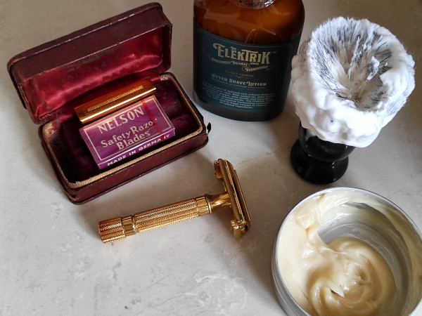 Close up image of a home wet shaving kit. Contents are as mentioned in the caption.