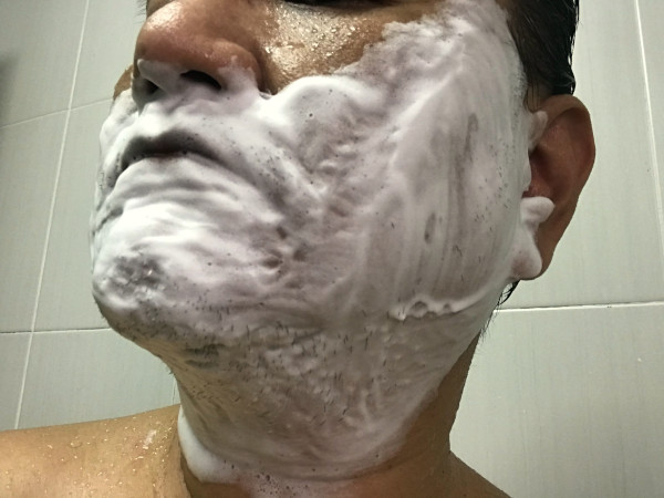 Close up of a lathered face, pre-shave, showcasing the rich and stable lather of The Elektrik Chair Overload shaving cream in action.