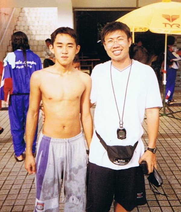 A picture of KT and his coach, Peh Gin Hai during his swimming days.