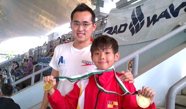 A picture of Kee Tzuen with one of his students that he coached during his career path at Advanced Aquatics.