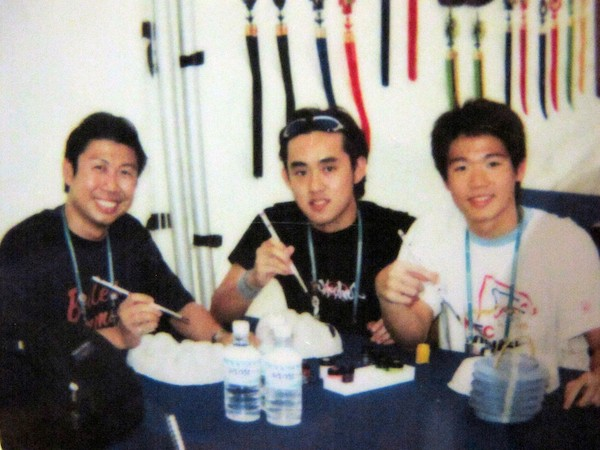 A picture of Kee Tzuen, his mentor Peh Gin Hai and another swimmer Dai Dai Look at the Summer Universaide Games 2003 in Daegu, South Korea.