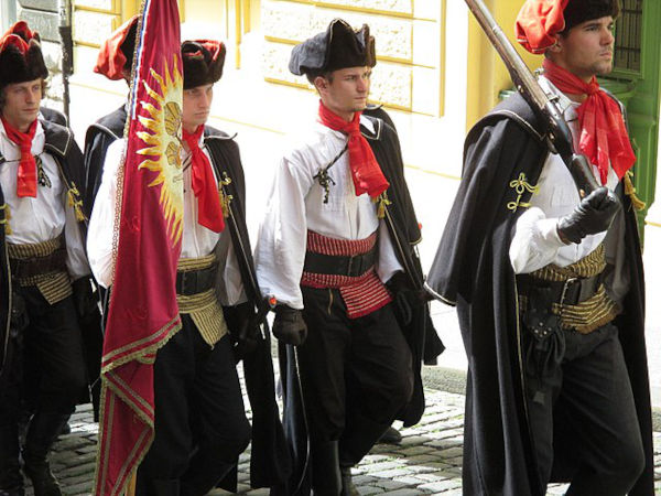 Modern-day Cravat Regiment in full uniform regalia reminiscence of the Croatian mercenaries (Croats) of the Thirty Years' War, showcasing the famous neckwear in bright red, the ancestor of all modern neckwear.