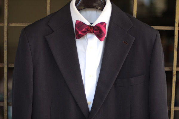 Close-up of an ensemble as described in the caption, matched with a solid white shirt and charcoal grey suit jacket.