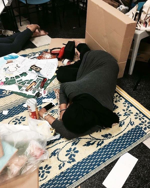 A photo of Salehah sleeping on the floor as she takes a rest from work.
