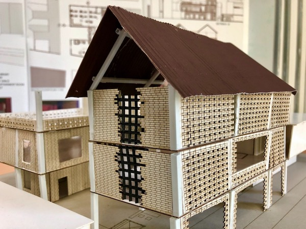A photo of Salehah's physical model of her Community Learning Centre project, showcasing the façade concept of brick vent block.