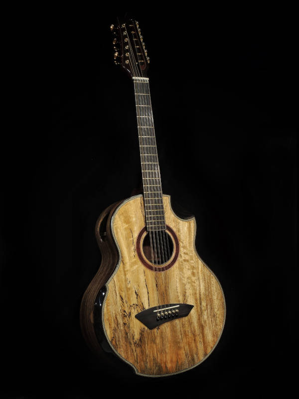A front view of the handmade Jumbo Mango 12-String Guitar clad in brown-coloured wood with traces of black patterns on the lower part of the guitar.