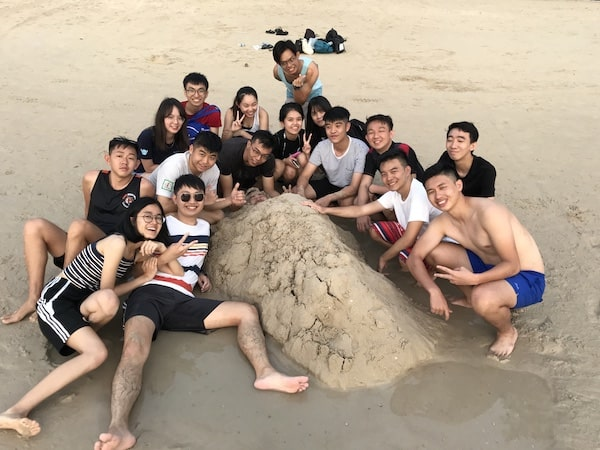 A picture of Kam and her friends at the beach in Phuket, enjoying their retreat after finishing degree.