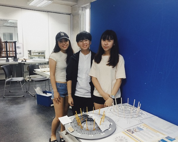A photo of Jia Xin and her group mates, Jeannete and Zi Shan. during their Millennium Dome Project.