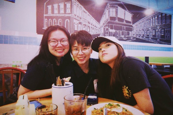Jia Xin and her friends, Xiao Yao and Jeannete, eating at a kopitiam.