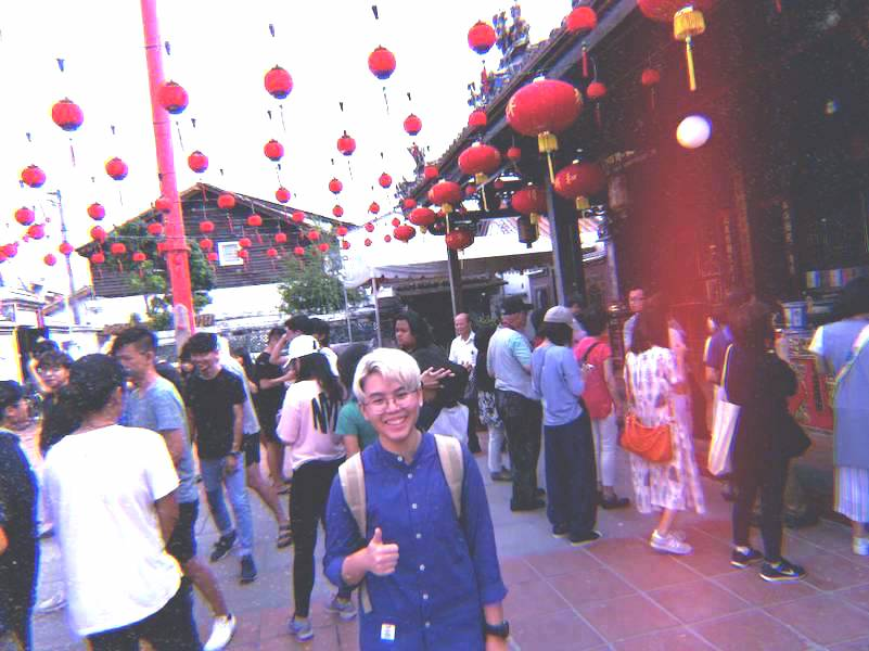 A photo of Jia Xin being a tourist amongst the crowds during her trip to Malacca for a project in 2018.